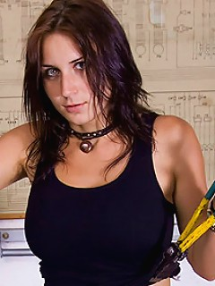 Mechanic Roxy Taggart plays with tits and cunt in a workshop
