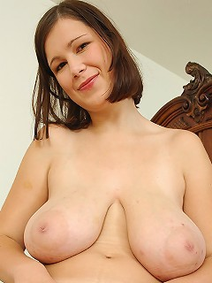 Babe Terry Nova showing off her giant melons and tight pussy