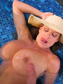 Kelly gives a blowjob in the pool in Cabo.