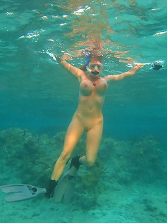 Kelly gets naked underwater and uses her 34ffs as floatation devices.