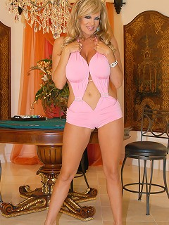 Poke Kelly Madison while she plays Poke-Her in a pink outfit.