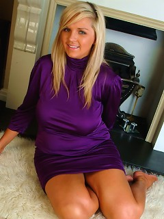 Ellie Jay cant contain her massive boobs in her purple dress