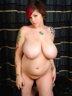 Rock chick plays with her huge natural tits